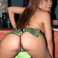 Latina MILF pornstar Tia Sweets displaying big booty in thong and high heels