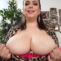 Obese solo girl Mia Sweetheart stripping down to pink bra and panty set on couch