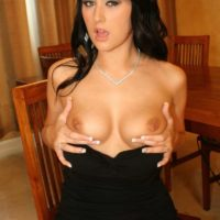Dark haired MILF Ashley showing her nice tits while having a cigarette