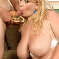 Fat blonde chick Scarlett Rouge eating food while engaging in oral sex activities