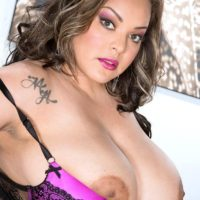 Fat solo model Cat Bangles letting her huge boobs slip free from bra in high heels