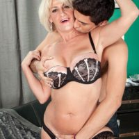 Hot older woman Desire Collins seducing younger man with huge dick in lingerie