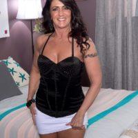 Over 50 brunette Azure Dee seducing younger man in mini skirt and high heels