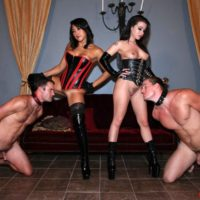 Brunette Dommes Adriana Lynn and Mia Li abuse collared and naked man slaves