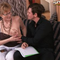 Granny in glasses seduces a younger man and sucks his cock on chesterfield