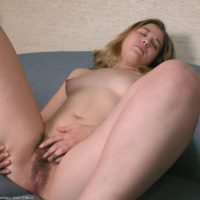 Amateur solo girl gets naked and plays with her hairy pussy