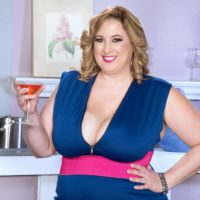 Blonde BBW Amiee Roberts frees her huge tits from her dress over a glass of wine