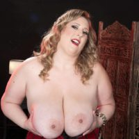 Blonde BBW Amiee Roberts plays with her huge boobs after pulling them out