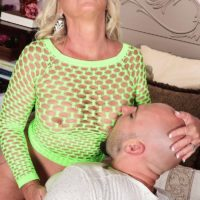 Blonde cougar Brandi Jaimes seduces a man in a see thru mesh dress and heels