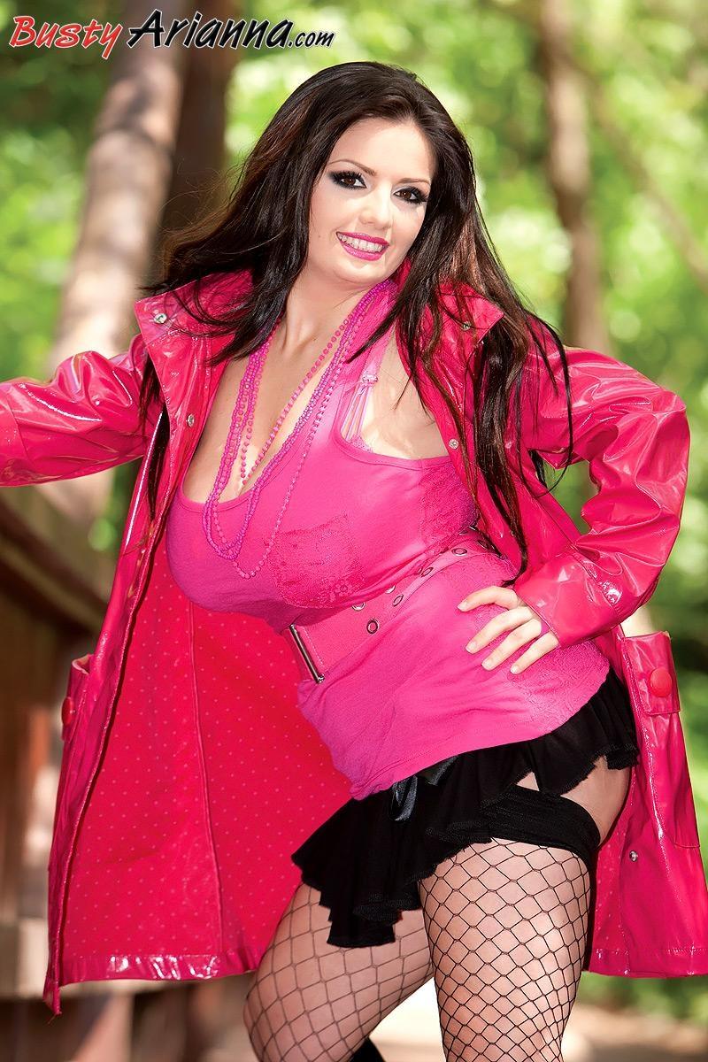Brunette plumper Arianna Sinn flashes her huge tits and upskirt ass outdoors