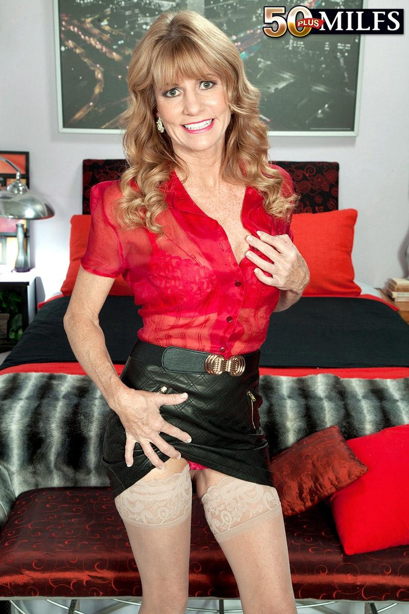 Hot older lady Denise Day seduces a younger man in leather miniskirt and nylons
