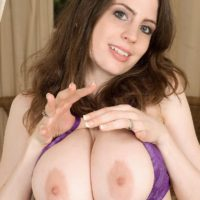 Solo girl Lillian Faye frees her big boobs from her bra before teasing her nipples