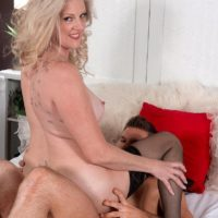 Mature blonde lady Val Kambel seduces a younger guy in hot lingerie and nylons