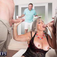 Mature woman Silva Foxx gives 2 men blowjobs in front of her cuckold husband