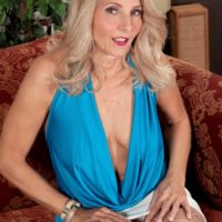 Older blonde lady Chery Leigh exposes her tits in tan stockings for her husband