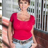 Over 60 lady Gina Milanos seduces a young boy with her big tits in denim shorts