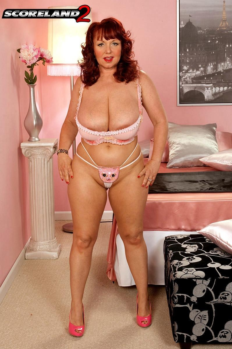 Redhead plumper Cherry Brady struts in her bra and panty ensemble and pink pumps