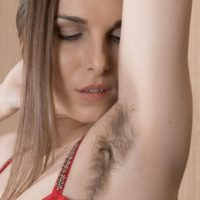Solo model Donatella shows off her hairy underarms and pussy in nude modeling debut