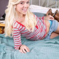 Young blonde girl Halle Von uncovers her tiny tits wearing cowgirl boots
