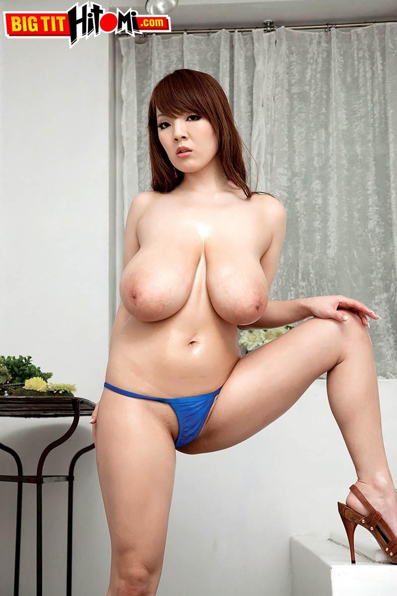 Asian MILF Hitomi releases her massive tits from her bikini top in high heeled shoes