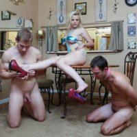 Blonde female Nadia White dominates two sissy men that worship her bare feet