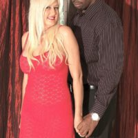 Blonde granny Marina Johnson has her first interracial sex experience in a red dress