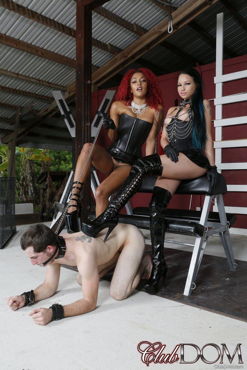 Dominatrix Daisy Ducati and her girlfriend dominate a male sub in high heels