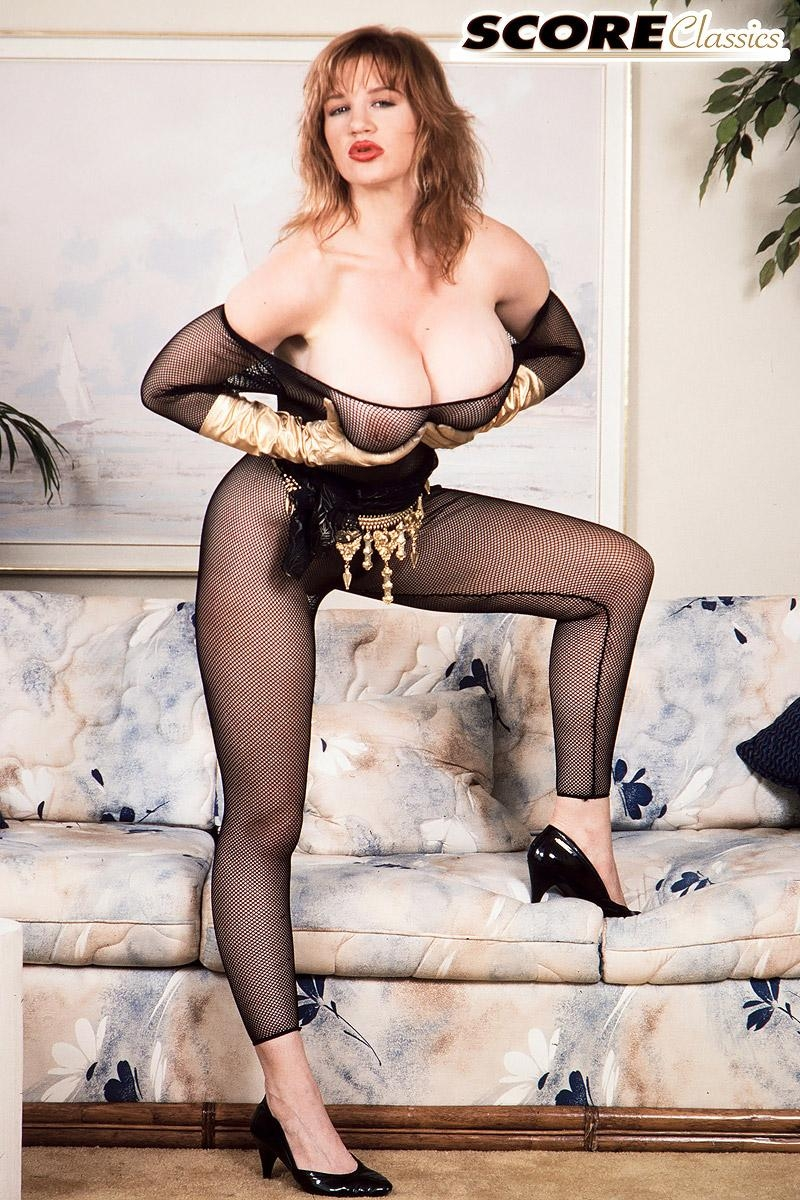 Famous pornstar Ashley Bust removes her huge boobs from crotchless bodystocking