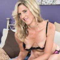 Hot mature woman Lauren De Wynter seduces younger man and gives him a blowjob