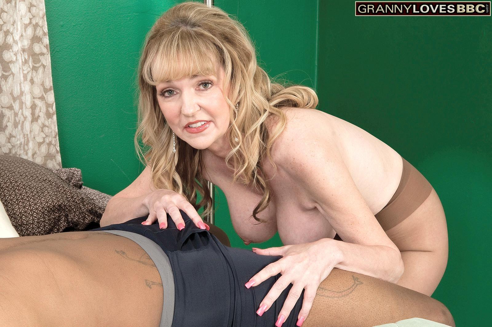 Petite granny Janee Diamond exposes her big tits before sucking a big black dick