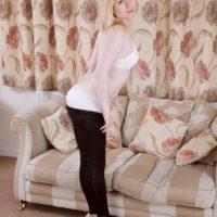 18 year old blonde girl Satine Spark strips to her white bra and underwear set