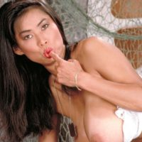 Asian solo model Minka releases her massive boobs from her bra army fatigues