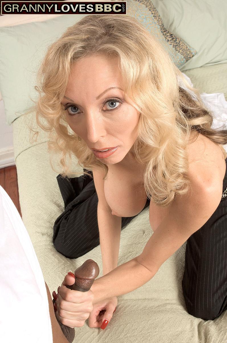 Big titted blonde granny Ophelia Vixxxen pleasures the big black dick of a younger man