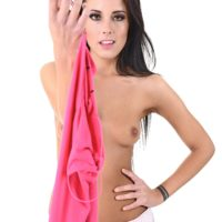 Brunette solo girl Lexi Layo uncovers her small boobs as she takes off her clothes