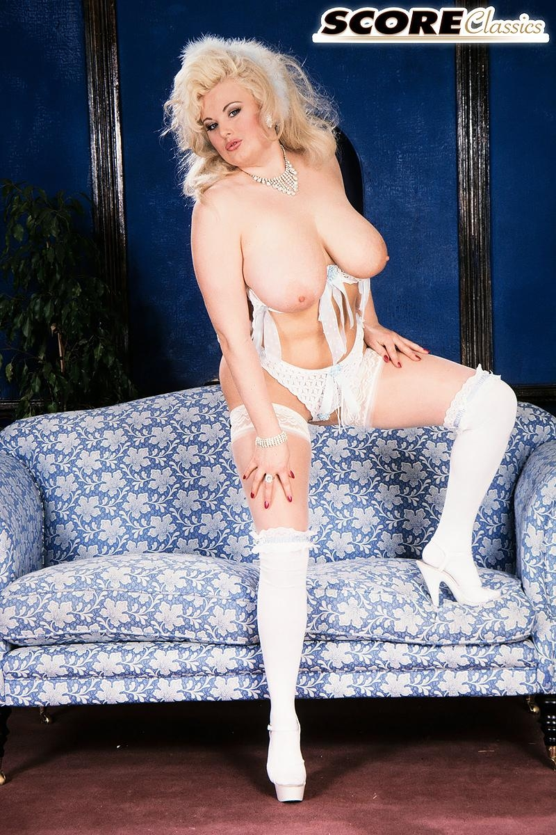 Famous blonde pornstar Toni Evans lets her large tits fall loose in over the knee nylons