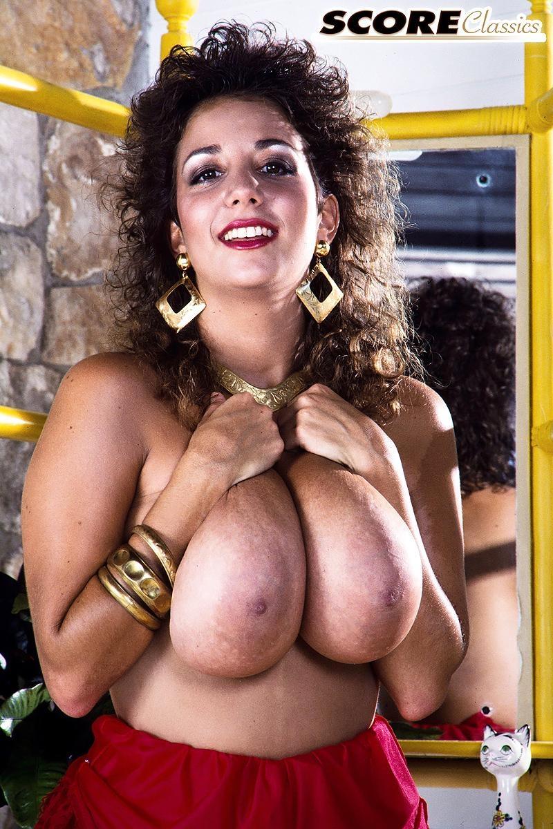 Famous pornstar Devon Daniels flaunts her massive tits wearing black stockings