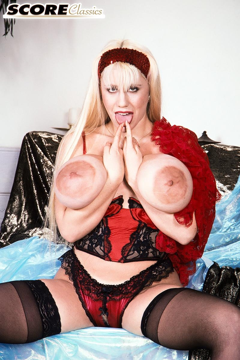 Famous pornstar Honey Moons has tits so big she can lick her own nipples with ease