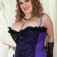 Fat solo model Smiley Emma exposes her massive tits in mesh hose and arm socks