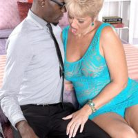 Horny granny Tracy Licks seduces a younger black man by flashing her big natural tits