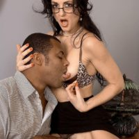 Hot older lady Lake Russell seduces a boy with a big black dick in his pants