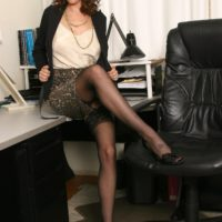 Hot older lady strips to her black stockings only in her home office