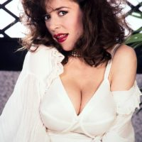 Mature pornstar Diana Wynn releases her huge boobs from her retro styled brassiere