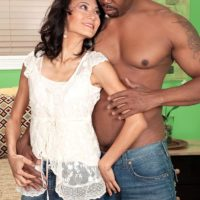 Petite grandmother Sahara Blue has her hairy vagina fingered by a black stud