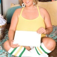 Blonde BBW Anna Kay unleashes her large boobs in knee high sport socks