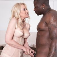 Blonde granny Robin Pachino seduces a man with a big black dick outdoors