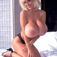 Famous pornstar Busty Dusty unveils her massive tits in sheer panties and high heels