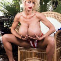 Famous pornstar Pandora Peaks releases her massive tits from a USA themed bikini