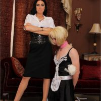 Hot brunette Emmanuelle London puts her subby hubby in a maid outfit
