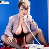 Mature MILF Tracy West sets her huge boobs loose in mesh stockings and heels