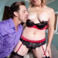 Mature wife with blonde hair Rebecca Williams seduces her husband in lingerie and nylons